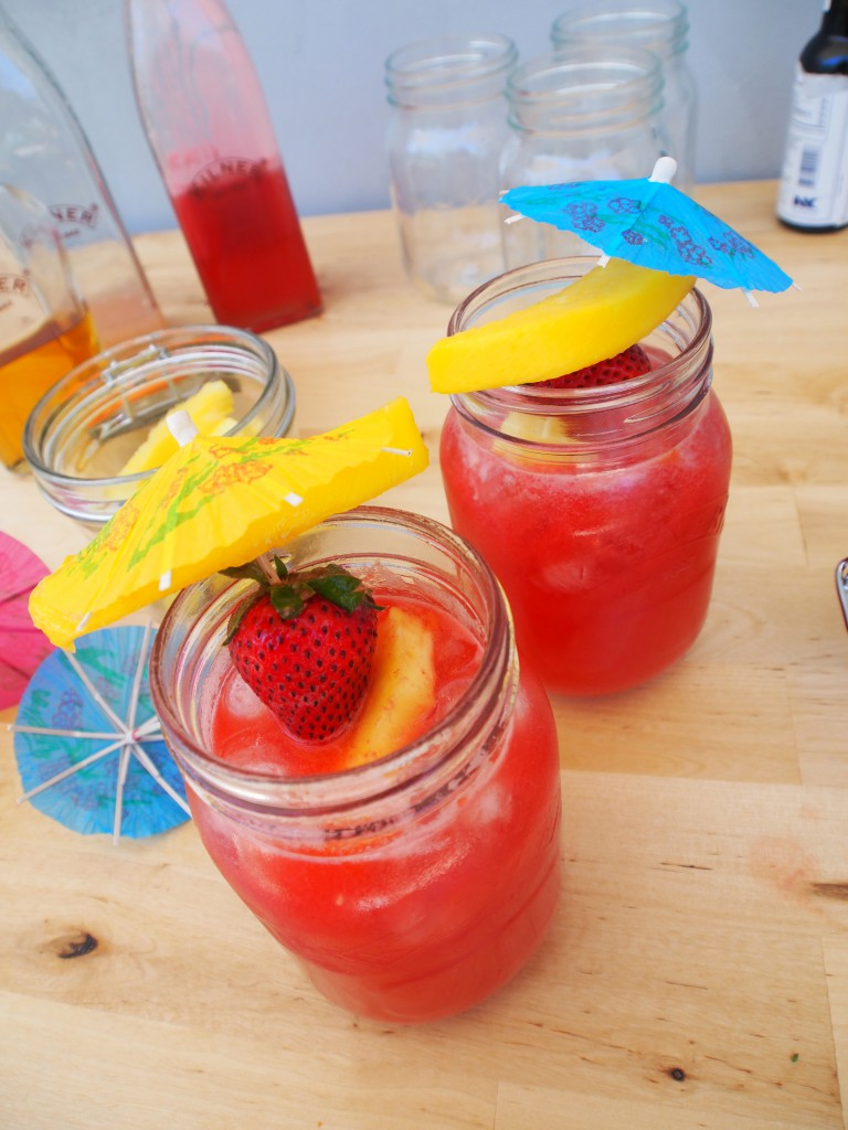 cocktail with strawberries, served in jars