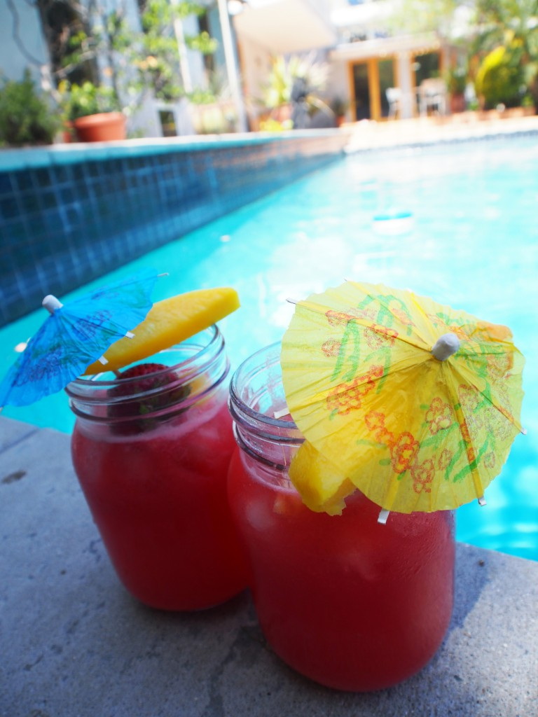 enjoying drinks in Kilner jars poolside